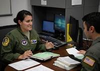 Capt. Karen Miller, 37th Flying Training Squadron instructor pilot, teaches 2nd Lt. Al Vitacco, 14th Student Squadron student pilot, about the fundamentals of flying Nov. 15, 2017, at Columbus Air Force Base, Mississippi. Miller is a First Assignment Instructor Pilot, meaning she graduated pilot training and her first assignment was to teach officers how to fly the T-6A Texan II. (U.S. Air Force photo by Airman 1st Class Beaux Hebert)