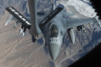 An F-16 Fighting Falcon assigned to the 77th Expeditionary Fighter Squadron, Bagram Airfield, Afghanistan prepares to be refueled by a KC-135 Stratotanker from the 340th Expeditionary Air Refueling Squadron Det 1 over the skies of Afghanistan. F-16s  are used to provide vital air support to Afghan and coalition forces on the ground.(U.S. Air Force photo by Staff Sgt. Sean Martin) (Released)(U.S. Air Force photo by Staff Sgt. Sean Martin)