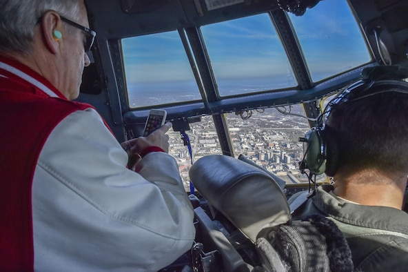 Youngstown State University President Jim Tressel, also the honorary commander of the 910th Airlift Wing, views downtown Youngstown and Youngstown State University from the flight deck of a 910th C-130H Hercules aircraft, Nov. 20, 2017.