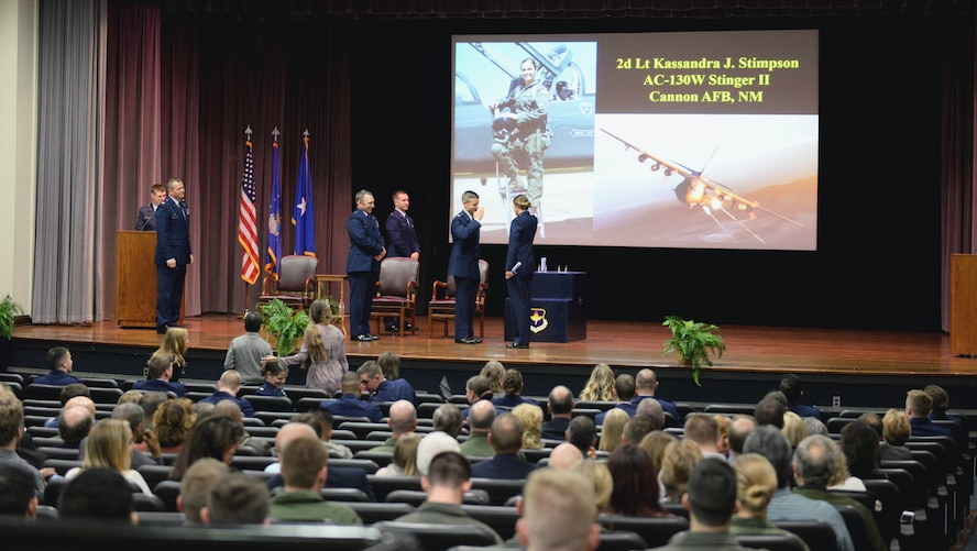 The 14th Flying Training Wing leadership and Brig. Gen. David W. Hicks award members of Specialized Undergraduate Pilot Training Class 18-02 with their coveted Air Force pilot wings Nov. 17, 2017, on Columbus Air Force Base, Mississippi. Almost every three weeks a graduation ceremony takes place marking the end of pilot training for student pilots and the beginning of their career alongside some of the greatest aviators in the world. Hicks is the Director of Strategy, Concepts, and Assessments, Deputy Chief of Staff for Strategic Plans and Requirements, Headquarters U.S. Air Force in Washington, D.C. (U.S. Air Force photo by Airman 1st Class Keith Holcomb)