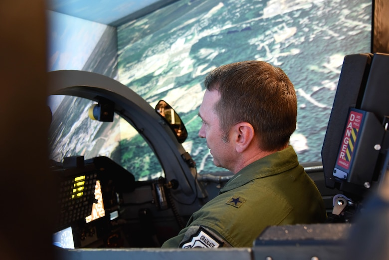 Brig. Gen. David Hicks, the Director of Strategy, Concepts, and Assessments, Deputy Chief of Staff for Strategic Plans and Requirements, Headquarters U.S. Air Force in Washington, D.C., flies in a T-38C Talon flight simulator, Nov. 17, 2017, on Columbus Air Force Base, Mississippi. Hicks spoke at Specialized Undergraduate Pilot Training Class 18-02's graduation ceremony and took the rest of the day to learn about Columbus AFB and see the changes in pilot training since his time at Columbus AFB 27 years ago. (U.S. Air Force photo by Melissa Dublin)