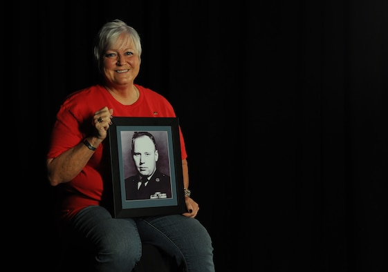 Nora Moore, daughter of Chief Master Sgt. Thomas Moore, Vietnam War prisoner of war and missing in action, holds a photo of her dad, Sept. 22, 2017, on Keesler Air Force Base, Mississippi. Thomas Moore was captured in South Vietnam by the Viet Cong and has been listed as a POW/MIA due to his remains not being found. Nora, was recently recognized as the first person in Keesler history to receive Gold Star Family status. (U.S. Air Force photo by Senior Airman Holly Mansfield)