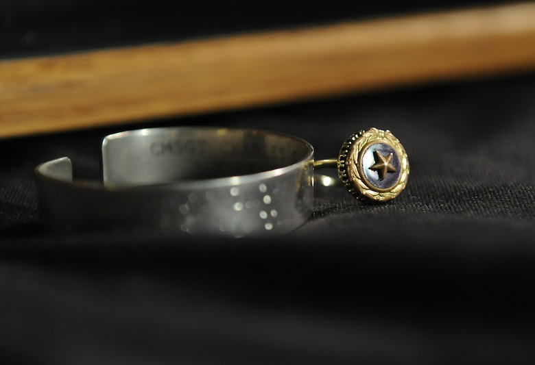A Gold Star Family Member ring and prisoner of war and missing in action bracelet belonging to Nora Moore, daughter of Chief Master Sgt. Thomas Moore, Vietnam War POW/MIA, are displayed, Sept. 22, 2017, on Keesler Air Force Base, Mississippi. Thomas Moore was captured in South Vietnam by the Viet Cong and has been listed as a POW/MIA due to his remains not being found. Nora, was recently recognized as the first person in Keesler history to receive Gold Star Family status. (U.S. Air Force photo by Senior Airman Holly Mansfield)