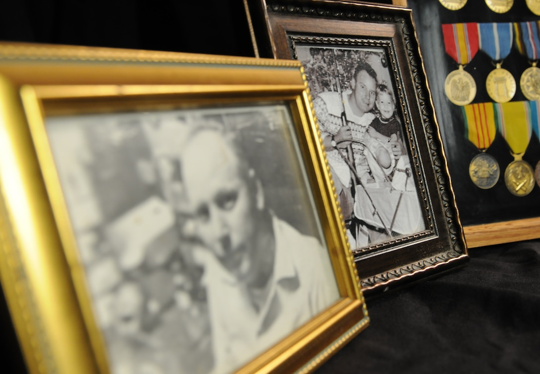 Photos of Chief Master Sgt. Thomas Moore, Vietnam War prisoner of war and missing in action, are displayed, Sept. 22, 2017, on Keesler Air Force Base, Mississippi. Moore was captured in South Vietnam by the Viet Cong and has been listed as a POW/MIA due to his remains not being found. Nora Moore, his daughter, was recently recognized as the first person in Keesler history to receive Gold Star Family status. (U.S. Air Force photo by Senior Airman Holly Mansfield)