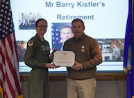 Col. Stacy Huser, 90th Missile Wing commander, presents the outstanding civilian career service award to Berry Kistler, 90th Inspector General, November 8, 2017, on F.E. Warren Air Force Base Wyo. Kistler plans to move to Arizona and enjoy life and relax with his family. (U.S. Air Force photo by Airman 1st Class Braydon Williams)