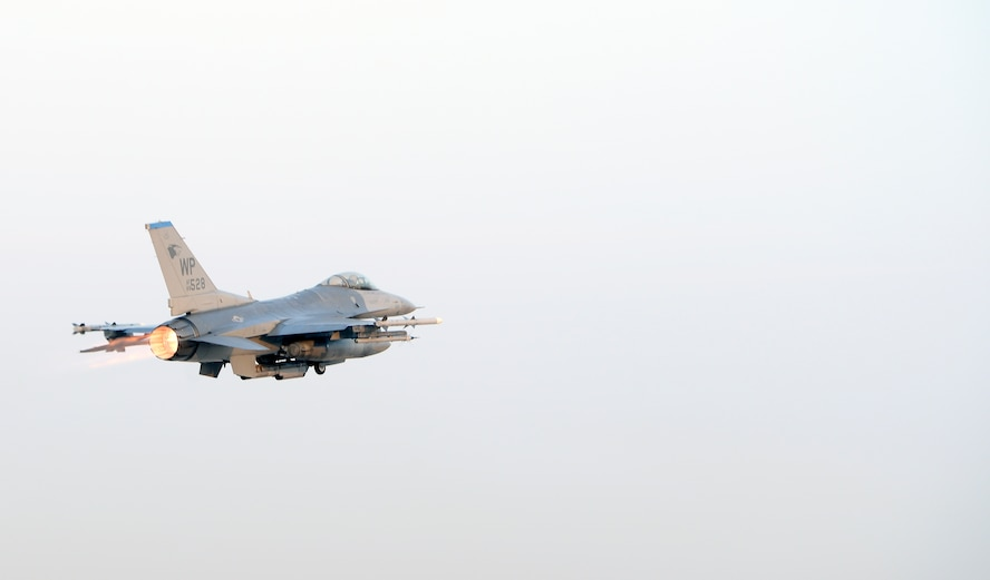 A U.S. Air Force F-16 Fighting Falcon with the 35th Fighter Squadron takes off from Kunsan Air Base, Republic of Korea, Nov. 17, 2017 during a large force employment. The 8th Fighter Wing launched more than 20 jets in support of the Large force employment which consist of greater numbers or aircraft and allows the wing to practice different aerial tactics in a larger air space. (U.S. Air Force photo by Senior Airman Colby L. Hardin)
