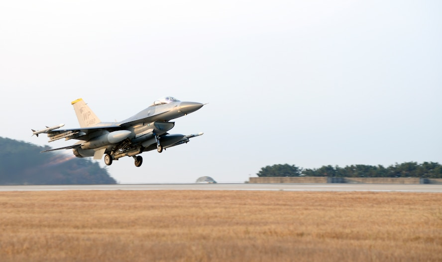 A U.S. Air Force F-16 Fighting Falcon with the 80th Fighter Squadron takes off from Kunsan Air Base, Republic of Korea, Nov. 17, 2017 during a large force employment drill in which the 8th Fighter Wing launched more than 20 jets, testing the combat operations with a larger number of aircraft. The 8th FW regularly tests its ability to launch a large number of jets in a short amount of time. (U.S. Air Force photo by Senior Airman Colby L. Hardin)