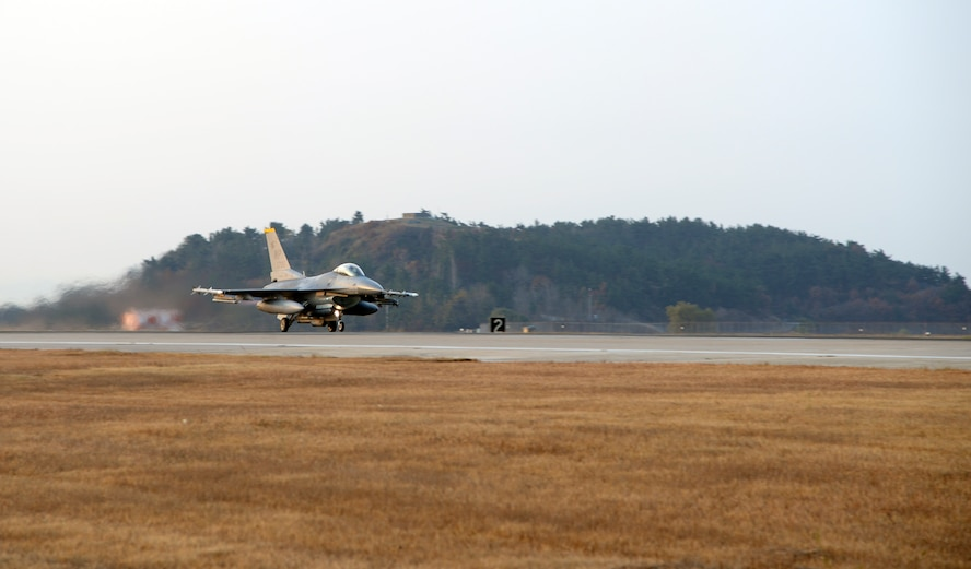 A U.S. Air Force F-16 Fighting Falcon taxis on the runway at Kunsan Air Base, Republic of Korea, Nov. 17, 2017 during a large force employment. The 8th FW regularly tests its ability to conduct LFEs in exercises and regular training, giving pilots, maintainers and support personnel the scenarios they need to validate their ability to launch large numbers of aircraft in a short amount of time. (U.S. Air Force photo by Senior Airman Colby L. Hardin)