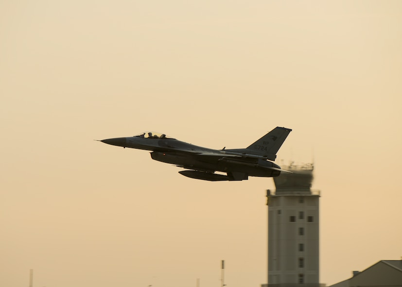 A U.S. Air Force F-16 Fighting Falcon with the 35th Fighter Squadron takes off from Kunsan Air Base, Republic of Korea, Nov. 17, 2017 during a large force employment drill in which the 8th Fighter Wing launched more than 20 aircraft to test its ability to conduct combat operations with large numbers jets in the air. The 8th FW regularly tests its ability to conduct LFEs in exercises and regular training, which gives pilots, maintainers and support personnel the scenarios they need to validate their ability to launch large numbers of aircraft in a short amount of time. (U.S. Air Force by Capt. Chris Mesnard)