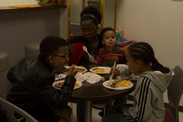 CAMP FOSTER, OKINAWA, Japan – A family dines together during the USO Thanksgiving Dinner Nov. 21 at the USO aboard Camp Foster, Okinawa, Japan.