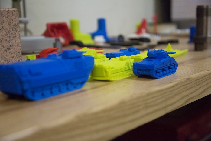 Several 3-D-printed assault vehicle models sit on display in the General Support Maintenance Company (GSM), 3rd Maintenance Battalion, 3rd Marine Logistics Group, as a display of advanced capabilities, Nov. 21 2017, at Camp Kinser, Okinawa, Japan. The Dreamer Flashforge 3-D printer is regularly used at GSM to test form, fit and functionality of equipment and military systems before the finished product is produced out of metal.