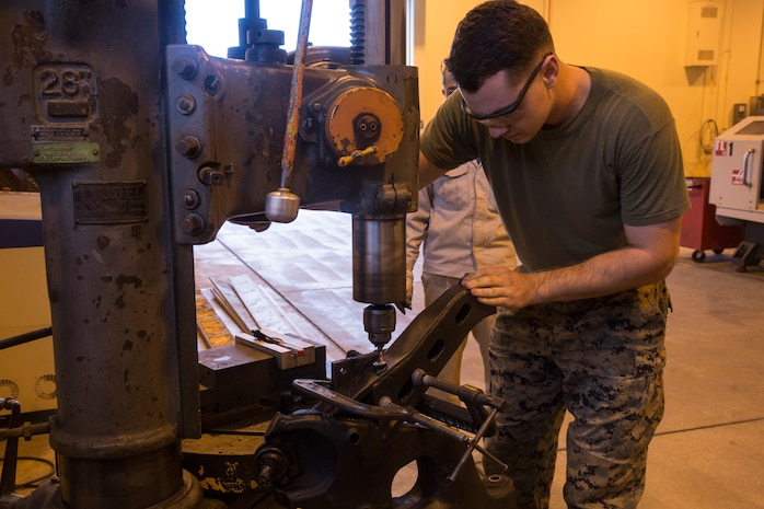 Cpl. Devin Perrell, a repair shop machinist and native of Bear Creek, N.C., removes a bolt stuck in a Humvee's pitman arm by drilling a hole through it and using an extractor to pull it out, Nov. 21, 2017, at Camp Kinser, Okinawa, Japan. The pitman arm is the piece of a vehicle that holds the wheel hub to the vehicle itself. The vehicle hardware was given to General Support Maintenance Company (GSM), 3rd Maintenance Battalion, 3rd Marine Logistics Group for repairs.