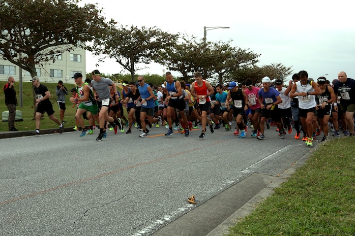 Runners take off at the start of the 28th Annual Kinser Half Marathon Nov. 19 aboard Camp Kinser, Okinawa, Japan. The run was open to participants island wide. The 13.1-mile run brought the military and local communities together for a friendly competition. After the race, runners celebrated their accomplishments with delicious food and drinks.