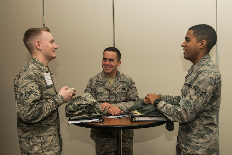 U.S. Air Force Airman 1st Class David Collins, 20th Operations Support Squadron airfield management operations coordinator, left, Airman 1st Class Nathan Parker, middle, and Airman Angel Hernandez, 20th Aircraft Maintenance Squadron tactical aircraft maintainers, chat during a Welcome Weasel Commander Breakfast at the Carolina Skies Club and Conference Center at Shaw Air Force Base, South Carolina, Nov. 20, 2017.