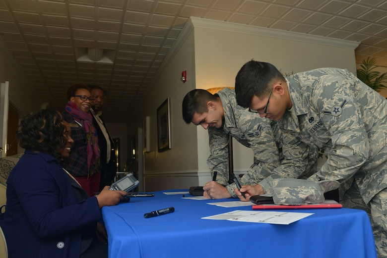 U.S. Airmen sign in at the front desk of the Welcome Weasel Commander Breakfast at the Carolina Skies Club and Conference Center at Shaw Air Force Base, South Carolina, Nov. 20, 2017.