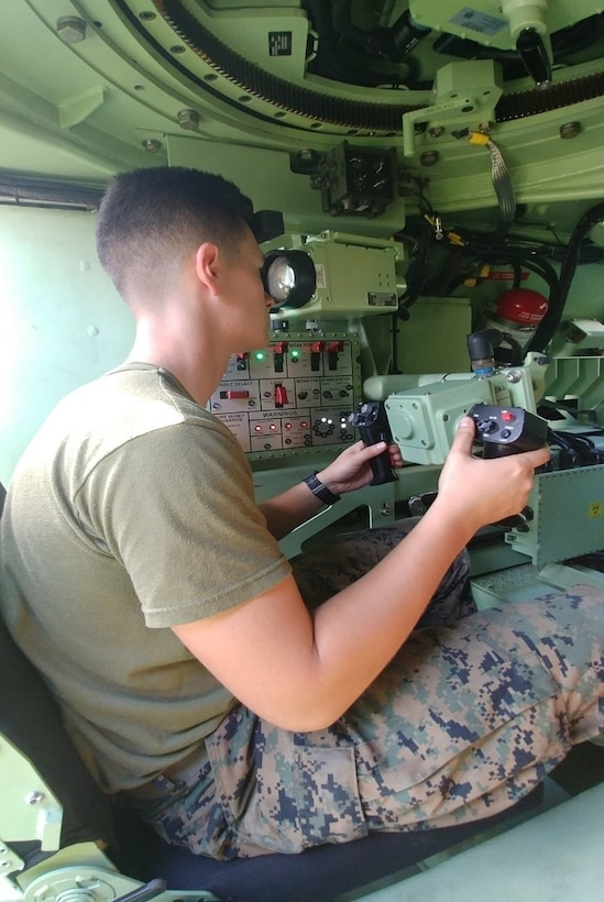 A Marine tests the enhanced vision capability—part of an upgrade to the Light Armored Vehicle's Anti-Tank Weapon System—during new equipment training Sept. 18-29, at Camp Pendleton, Calif.  Marine Corps Systems Command completed its first fielding of four upgraded ATWS in September.