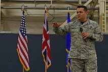 Chief Master Sgt. Ernesto J. Rendon, 48th Fighter Wing command chief master sergeant, addresses the audience during a wing all-call Sept. 1 at Royal Air Force Lakenheath, England. Rendon recently chartered a Quality of Life initiative where experts in continuous process improvement conducted forums to hear concerns of Airmen, civilian personnel, and spouses.