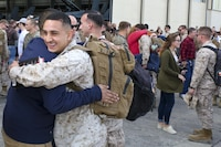 Cpl. Byron Miranda hugs a fellow Marine after returning from a seven month deployment, Nov. 21, aboard Marine Corps Air Station Beaufort. Marine All-Weather Fighter Attack Squadron 224 left for the deployment to support combat operations in the Central Command area of operations, May 8. Miranda is with VMFA(AW)-224.