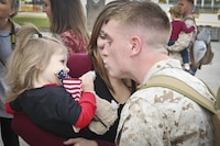 A Marine greets his family after returning from a seven month deployment, Nov. 21, aboard Marine Corps Air Station Beaufort. Marine All-Weather Fighter Attack Squadron 224 left for the deployment to support combat operations in the Central Command area of operations, May 8. The Marine is with VMFA(AW)-224.