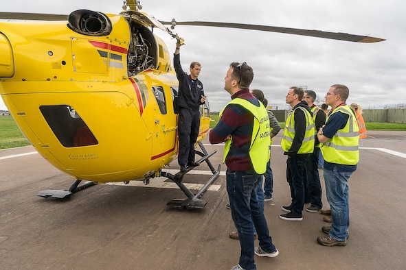 Pilot Matt Sandbach, with the East Anglian Air Ambulance, answers questions and discusses the inner workings of an Airbus H145's power-plant engines with maintainers from the 352d Special Operations Maintenance Squadron, 352d Special Operations Wing. The H145 is capable of cruising at 158 mph to respond to regional emergencies. The 352 SOMXS visit was a part of the Honorary Commander Program, which provides a unique opportunity for local area community members to shadow 352 SOW leaders to encourage an exchange of ideas, share experiences and foster a supportive relationship with the community.