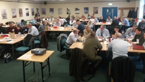 Quality assurance members from DCMA United Kingdom and others collaborate during a partner nation event.