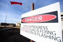 A red flag is displayed to indicate active weapons training at the combat arms training and maintenance range Nov. 20, 2017, at McConnell Air Force Base, Kansas. Airmen attend CATM prior to deployment, some permanent changes of station and annually for Airmen who carry weapons on a daily basis for their job. (U.S. Air Force photo by Airman Michaela R. Slanchik)