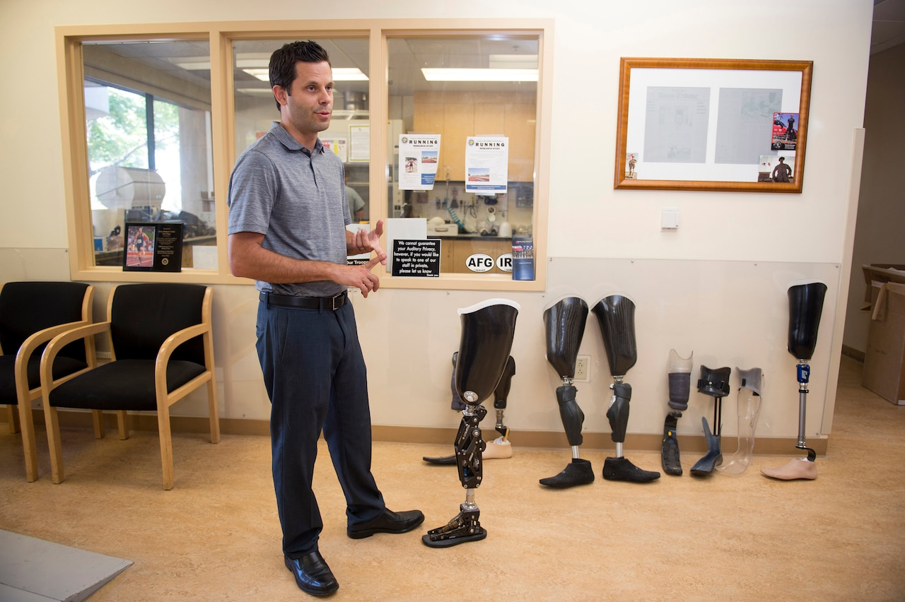 Brian Zalewski, head of prosthetics at Naval Medical Center San Diego, discusses the custom prosthetics built at the hospital, Sept. 15, 2017. DoD photo by EJ Hersom