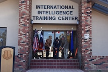 Brenda Gunter, San Angelo mayor, U.S. Air Force Col. Ricky Mills, 17th Training Wing commander, and Stephen Floyd, Tom Green County judge, cut the ribbon for the International Intelligence Training Center on Goodfellow Air Force Base, Texas, Nov. 21, 2017. With aid from both local and state support Goodfellow was able to complete this commitment toward international intelligence training. (U.S. Air Force photo by Airman 1st Class Zachary Chapman/Released)