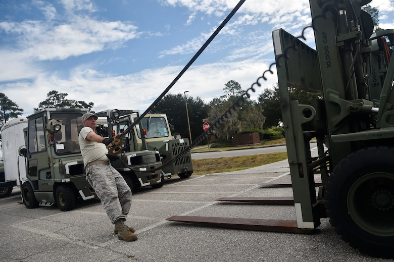 Staff Sgt. Jesse Turner, 628th Logistics Readiness Squadron operator, records and licensing NCO in Charge, prepares to move a forklift Nov. 14, 2017, at Joint Base Charleston, S.C. The 628th LRS transported approximately 38 pallets weighing roughly 130 short tons and issued about two million gallons of fuel for aircraft and ground vehicles in support of Hurricane Maria relief efforts to Puerto Rico.