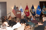 DLA Troop Support Clothing and Textiles Strategic Material Sourcing Division Chief Donna Pointkouski speaks to representatives from nearly 500 U.S. clothing and textiles manufacturers, the military services and government representatives during the third annual Joint Advanced Planning Brief for Industry November 15, 2017. The two-day meeting in Cherry Hill, New Jersey served as an opportunity for the DLA and the military to brief industry partners on their expectations for clothing and individual equipment requirements over the next year.