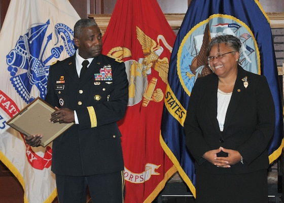 LTG Williams, Chief of Staff Roman, facing viewer