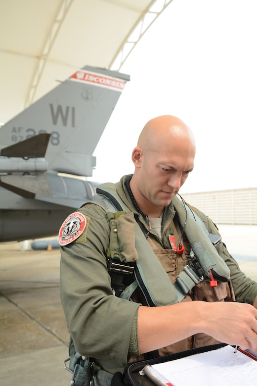 "Maj. Ryan ""Stalker"" Gaffaney, a pilot with the 176th Expeditionary Fighter Squadron prepares for launch at Kunsan Air Base, Republic of Korea, Sept. 19, 2017. Airmen from the 115th Fighter Wing, Wisconsin Air National Guard, are deployed to Kunsan for a 3-month rotation as part of a Theater Security Package, which helps to maintain a deterrent against threats to regional security and stability. (U.S. Air National Guard photo by Tech. Sgt. Meghan Skrepenski)"