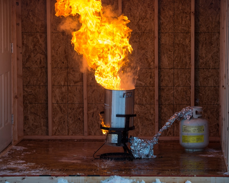 A turkey fryer is engulfed in flames during a fire safety demonstration at Joint Base Elmendorf-Richardson, Alaska, Nov. 13, 2017. The demonstration raised public awareness on the dangers of deep-frying turkeys and showed what not to do along with proper turkey-frying techniques.