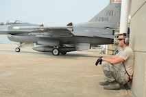 Staff Sgt. Chad Gaffney, a crew chief deployed with the 176th Expeditionary Aircraft Maintenance Unit and Senior Airman Molly Hermanson, an administrative journeyman with the 115th Fighter Wing, prepare an F-16 Fighting Falcon for launch at Kunsan Air Base, Republic of Korea, Sept. 19, 2017. Hermanson was able to assist with the launch through a Y-cord attached to her headset that allowed her to walk through alongside Gaffney.  Airmen from the 115th Fighter Wing, Wisconsin Air National Guard, are deployed to Kunsan for a 3-month rotation as part of a Theater Security Package, which helps to maintain a deterrent against threats to regional security and stability. (U.S. Air National Guard photo by Tech. Sgt. Meghan Skrepenski)