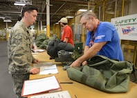 Keith Parks, 72nd Logistics Readiness Squadron, checks the C-Bag of Senior Airman Ryan Shirk, 72nd Force Support Squadron, in the mobility processing line Oct. 4, 2017, Tinker Air Force Base, Oklahoma.