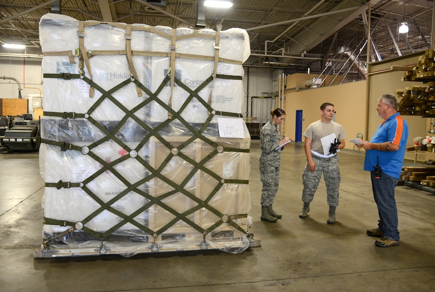 James Eye, 72nd Logistics Readiness Squadron, conducts an inspection of a pallet of medical supplies ready for loading for a potential deployment Oct. 4, 2017, Tinker Air Force Base, Oklahoma. Eye speaks with Senior Airmen Olivia Chapman and Nicholas Frazier, 72nd Medical Support Squadron, and lets them know what their team did correctly on building the pallet and what items they need to work on in the future.