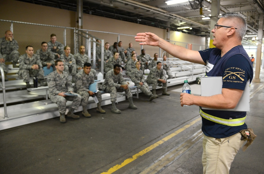 Brett Neeley, traffic management specialist, 72nd Logistics Readiness Squadron, instructs exercise deployers on the next phase of the mobility process Oct. 4, 2017, Tinker Air Force Base, Oklahoma.