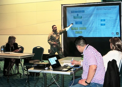 Maj. Juan Villatoro, a contracting officer with the U.S. Army Corps of Engineers, advises attendees at a meeting of the Puerto Rico Business Emergency Operations Center about Corps-related business opportunities associated with temporary power, debris removal, temporary roofing and restoration of the island's power grid.