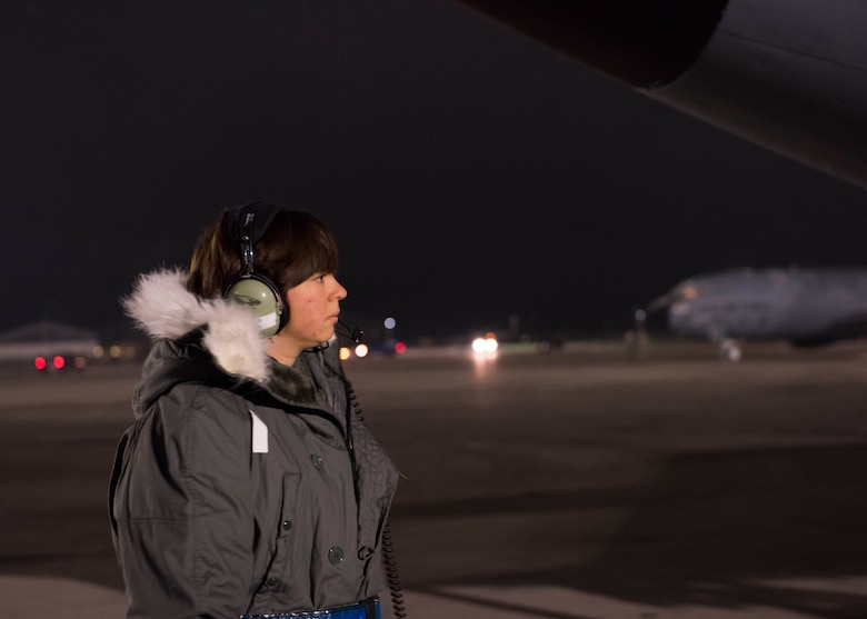 Senior Airman Megan Myers, 141st Maintenance Group crew chief, supervises KC-135 Stratotanker pre-flight checks during Exercise Global Thunder 2018 at Fairchild Air Force Base, Washington, Nov. 4, 2017. Global Thunder is an annual U.S. Strategic Command (USSTRATCOM) exercise designed to provide training opportunities to test and validate command, control and operational procedures. The training is based on a notional scenario developed to drive execution of USSTRATCOM and component forces' ability to support the geographic combatant commands, deter adversaries and, if necessary, employ forces as directed by the President of the United States. (U.S. Air Force photo/Senior Airman Ryan Lackey)