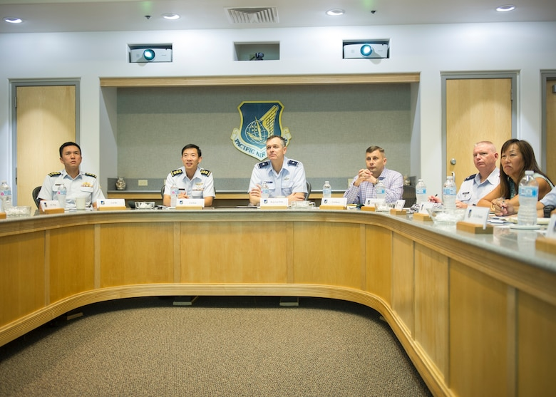 (Second from left) Republic of Singapore Air Force Col. Kelvin Fan, head of air operations, and U.S. Air Force Brig. Gen. Craig Wills, Pacific Air Forces director of strategy, plans and programs, listen to a briefing during a PACAF-RSAF Dialogue (PRD) at Joint Base Pearl Harbor-Hickam, Hawaii, Nov. 16-17, 2017.