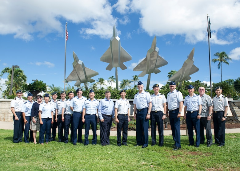 Members of the Pacific Air Forces (PACAF) and the Republic of Singapore Air Force (RSAF) Dialogue (PRD) pose for a group photo in front of the Missing Man memorial at Joint Base Pearl Harbor-Hickam, Hawaii, Nov. 17, 2017.