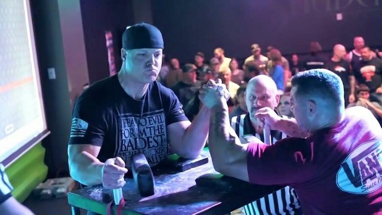 Tech. Sgt. Driggs arm wrestling