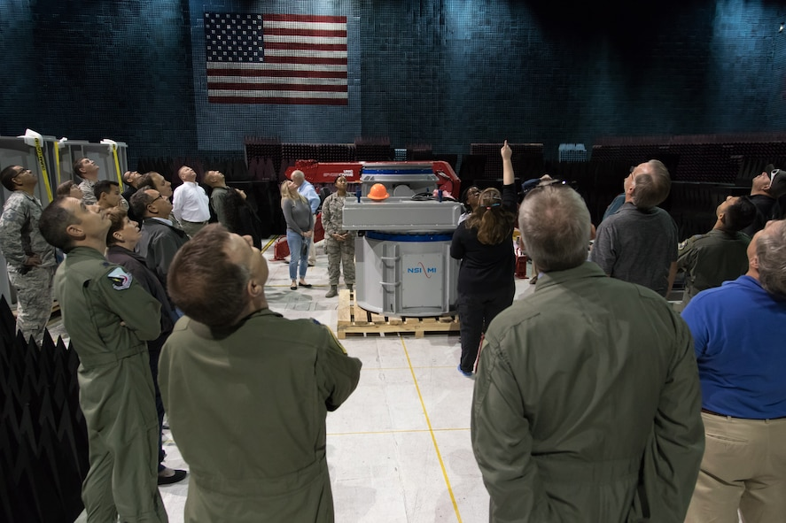 A group of honorary commanders, their guests, and commanders from Edwards units check out the aircraft hoist in the Benefield Anechoic Facility during an honorary commanders event here. The hoist is used to suspend aircraft in the building for electronic warfare systems testing. (U.S. Air Force photo by Don Allen)