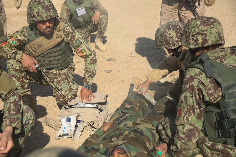 Afghan National Army soldiers with 6th Kandak, 1st Brigade, 215th Corps provide medical care to a notionally wounded soldier during casualty evacuation training at Camp Shorabak, Afghanistan, Nov. 19, 2017. As part of the operational readiness cycle, Afghan instructors at the Helmand Regional Military Training Center held the first iteration of CASEVAC training during the two-month course to help prepare its students for operations against the Taliban. U.S. advisors assigned to multiple train, advise, assist commands from throughout Afghanistan observed the simulation to implement standardized CASEVAC training into their respective RMTCs' training cycles. (U.S. Marine Corps photo by Sgt. Lucas Hopkins)