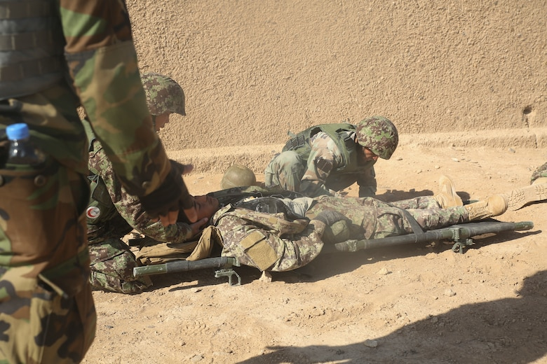 Afghan National Army soldiers with 6th Kandak, 1st Brigade, 215th Corps provide medical care to a notionally wounded soldier during casualty evacuation training at Camp Shorabak, Afghanistan, Nov. 19, 2017. Soldiers with the unit's 2nd Toli completed the first iteration of CASEVAC training as part of the operational readiness cycle, a two-month course led by Afghan instructors at the Helmand Regional Military Training Center. U.S. advisors with train, advise, assist commands from other provinces in Afghanistan received a first-hand look at the training in order to implement standardized CASEVAC simulation to their respective ORCs. (U.S. Marine Corps photo by Sgt. Lucas Hopkins)