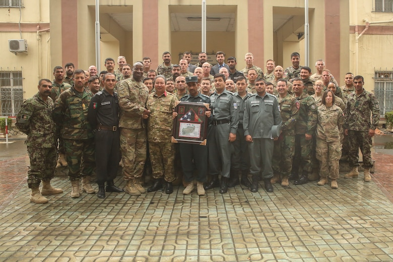 U.S. military and Afghan National Defense and Security Force personnel pose for a photo during a warfighter forum at Resolute Support Headquarters in Kabul, Afghanistan, Nov. 15, 2017. Senior enlisted U.S. and ANDSF leaders gathered for the two-day event to discuss current issues such as accountability, mortuary affairs, female integration and force protection, and formulated potential solutions to further develop the professionalism of the Afghan services. (U.S. Marine Corps photo by Sgt. Lucas Hopkins)
