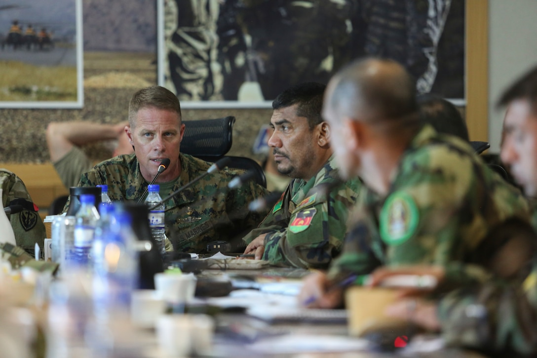 U.S. Marine Sgt. Maj. Darrell Carver, left, the sergeant major of Task Force Southwest, speaks about recent success against the Taliban in Helmand province during a warfighter forum at Resolute Support Headquarters in Kabul, Afghanistan, Nov. 15, 2017. The forum was a two-day event which saw senior enlisted U.S. and Afghan National Defense and Security Force leaders congregate to discuss challenges and potential solutions throughout the Afghan services. (U.S. Marine Corps photo by Sgt. Lucas Hopkins)