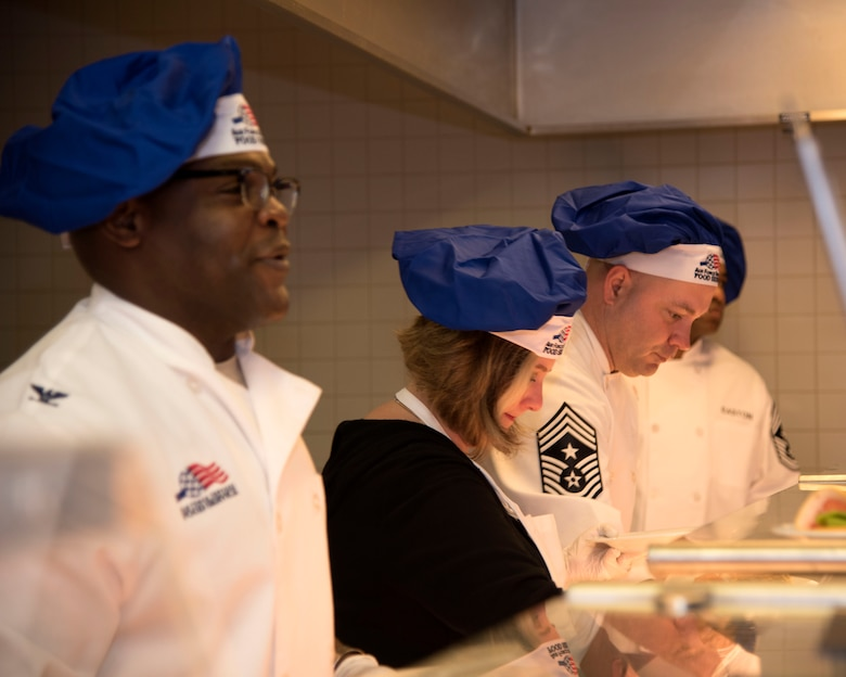 Col. Uduak Udoaka (left), 86th Logistics Readiness Group commander, serves Airmen during a Thanksgiving meal at Ramstein Air Base, Germany, Nov. 23, 2017.