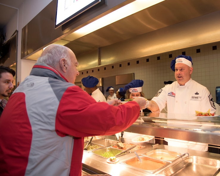 Chief Master Sgt. Aaron Bennett, 86th Airlift Wing command chief, serves meals during Thanksgiving at Ramstein Air Base, Germany, Nov. 23, 2017.
