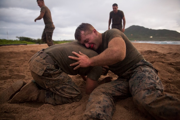 Cpl. David Waisner, a combat engineer with Combat Assault Company (CAC), 3rd Marine Regiment, grapples with another Marine for the 74th anniversary of the Battle of Tarawa, Fort Hase Beach, Marine Corps Base Hawaii (MCBH), Nov. 20, 2017. CAC celebrated the anniversary with a motivational run and beach grappling to promote comradery among the Marines, while understanding the sacrifices at Tarawa. MCBH, along with its tenant units, strives to promote resiliency in remembering the past battles won and to instill in the newest generation what it means to be U.S. Marine.